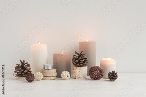 Fototapety, obrazy: Christmas candles, wood slice decorations, pine cone on white background