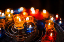 Lighted Candles In Colorful Ca...