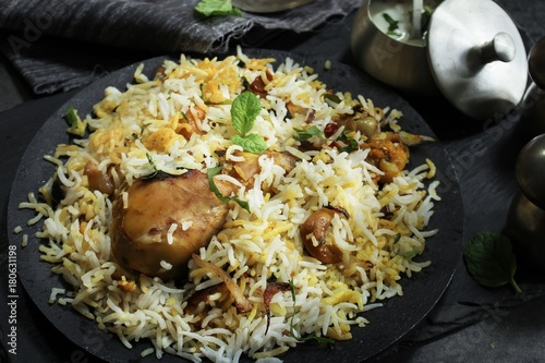 Overhead view of Homemade Chicken Biryani on dark moody background Canvas Print