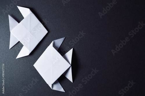 Obraz na plátně  origami fishes on dark background