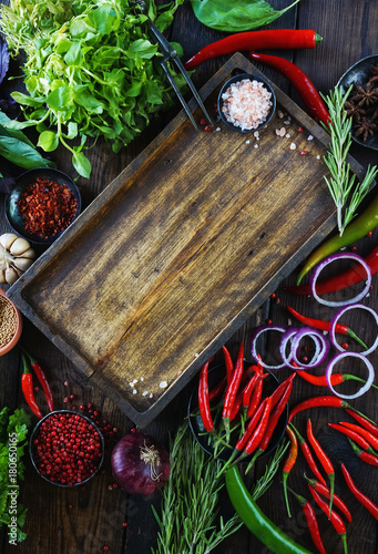 Poster Cuisine Fresh vegetables, spices and herbs in wooden box in rustic style. Raw organic healthy food concept