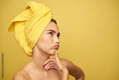 Stampa su Tela young girl with a towel on her head lost in thought