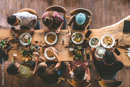 Group of happy friends having nice food and drinks, enjoying the party and communication, Top view of Family gathering together at home for eating dinner Tablou Canvas