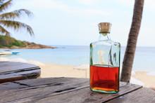 Beverrage Alcohol Is Brandy Bottle On Wood Table.