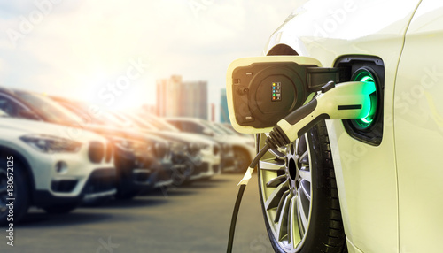 Платно Power supply connect to electric car for add charge to the battery