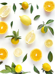 FototapetaFood pattern of fresh fruit in a cut. Oranges, lemons slices , tangerines with green leaves. Composition from fruits, top view, flat lay. Citrus fruits background, wallpaper.