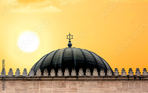 Fotografie, Obraz Dome of the synagogue with the sign of the star of David at sunset
