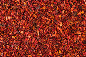 Fototapetadried tomato powder spice as a background, natural seasoning texture