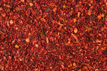 Fototapeta dried tomato powder spice as a background, natural seasoning texture