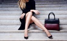 Fashion Model Sitting In Black...