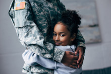 Daughter Hugging Soldier