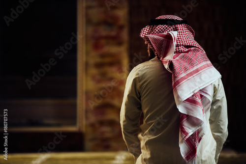 muslim man praying inside the mosque