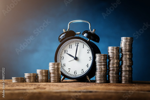 business financial loan refinance ideas concept with coins stack and alarmclock Fototapeta