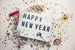 canvas print picture - Happy New year displayed on a vintage lightbox with decoration for New Year's Eve, concept image
