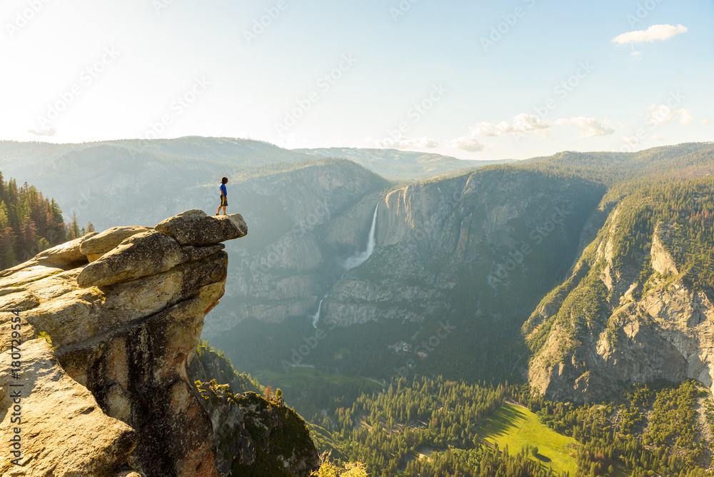 Fototapety, obrazy: Hiker at the Glacier Point with View to Yosemite Falls and Valley in the Yosemite National Park, California, USA