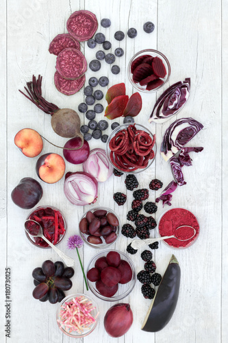 Health food of fruit and vegetables high in anthocyanins, antioxidants and vitamins of red, purple and blue foods. Healthy eating concept. Top view.