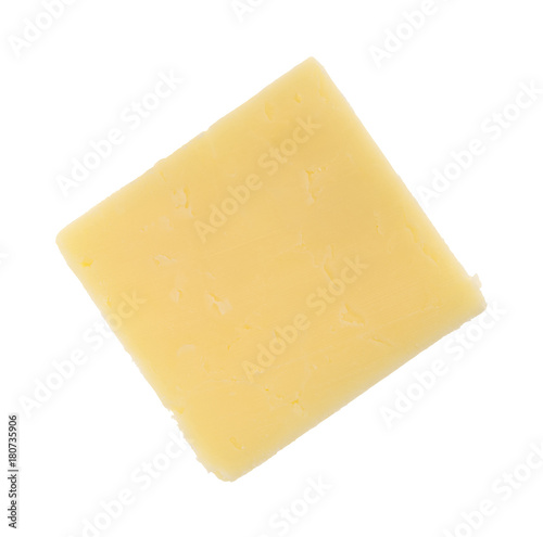Top view of a single slice of a sharp cheddar cheese square isolated on a white background.