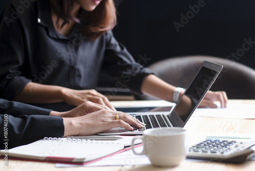 Close up of female accountant or banker making calculations Canvas Print