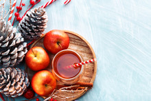 Seasonal And Holidays Concept. Winter Hot Tea In A Glass With Apples And Spices On A Wooden Background. Selective Focus, Top View