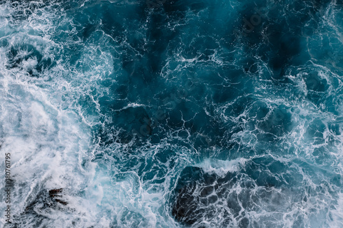 Aerial view to ocean waves. Blue water background - 180761795