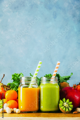 Canvas Print Freshly blended fruit smoothies of various colors and tastes in glass jars in rustic wooden tray