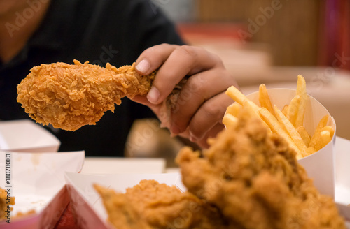 Young Boy hand hold fried chicken for eat , with fast food concept and diet © tool51