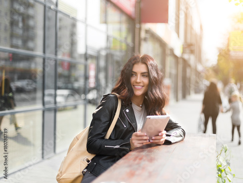 Young pretty spanish woman in cafe in city centre Canvas Print