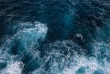 Aerial view to ocean waves. Blue water background - 180787147