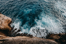 Aerial View To Ocean Waves And Rock Coast
