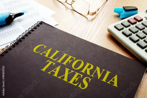 Fototapeta Book with California taxes on a desk.