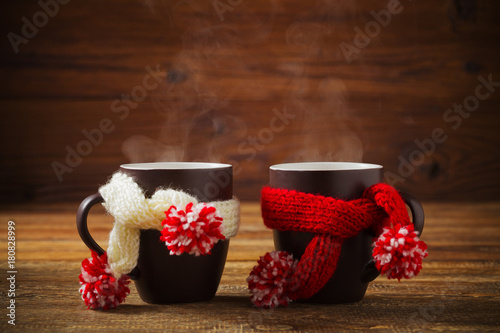 Cup with scarf with hot tea.