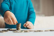 Child Coins Hands Slivaet In T...