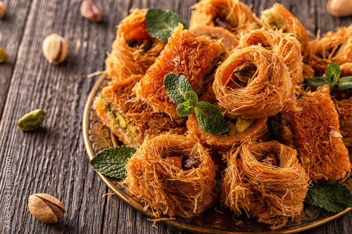 Photo Eastern sweets on old wooden table.