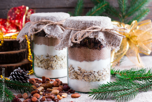 Obraz na plátně Chocolate chips cookie mix in glass jar for Christmas gift