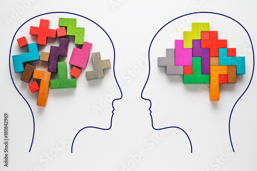Obraz The concept of rational and irrational thinking of two people. Heads of two people with colourful shapes of abstract brain for concept of idea and teamwork. Two people with different thinking. - fototapety do salonu