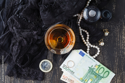 Underwear, cognac and money to symbolize the cost of sex Canvas Print