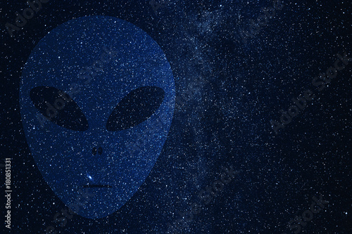 Photo  Alien face silhouette on background of Universe