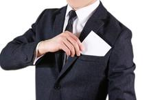 Businessman Putting Paper In S...