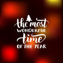 Vector The Most Wonderful Time Of The Year Lettering Design On Blurred Background. Christmas Or New Year Typography.