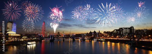London skyline, night view, fireworks over Hungerford Bridge and Big Ben #180858914