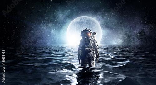 Spaceman in the sea. Mixed media Wallpaper Mural