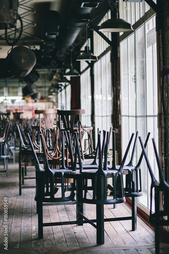 Photographie Chairs and tables stacked in a closed pub