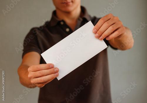 Man showing aslant blank white flyer brochure booklet Canvas Print