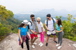 Tourist Group Watch Photos On Cell Smart Phones, People With Backpack Over Landscape From Mountain Top, Young Frineds On Hike