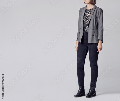 5e683229ee6 Woman wearing stylish and smart outfit with floral patterned blouse ...