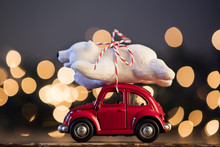 Christmas Background With Polar Bear On A Red Toy Car
