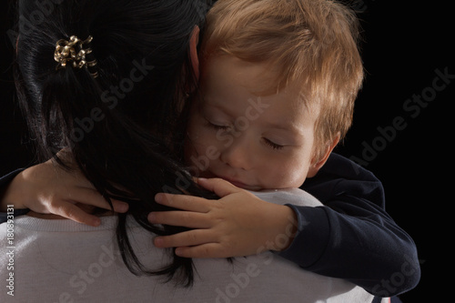 Photo Adoption concept, an orphan is a little boy and his new mother