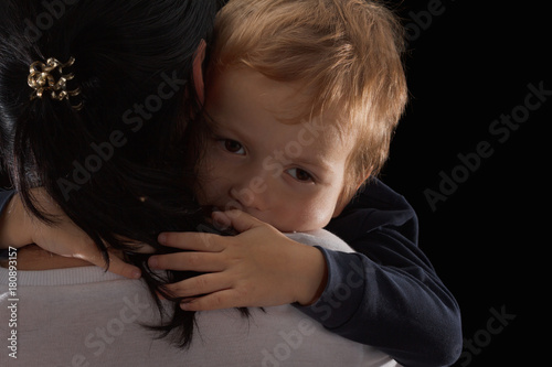 Adoption concept, an orphan is a little boy and his new mother Wallpaper Mural