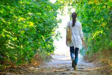 The Girl Walks Along The Path ...