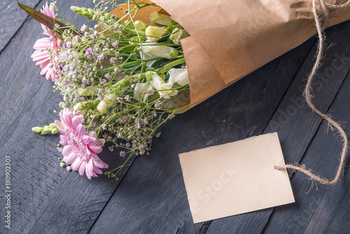 Message card and a bouquet of flowers greeting card idea with a message card and a bouquet of flowers greeting card idea with a cheerful bouquet of flowers wrapped in vintage brown paper and an empty etiquette tied to m4hsunfo
